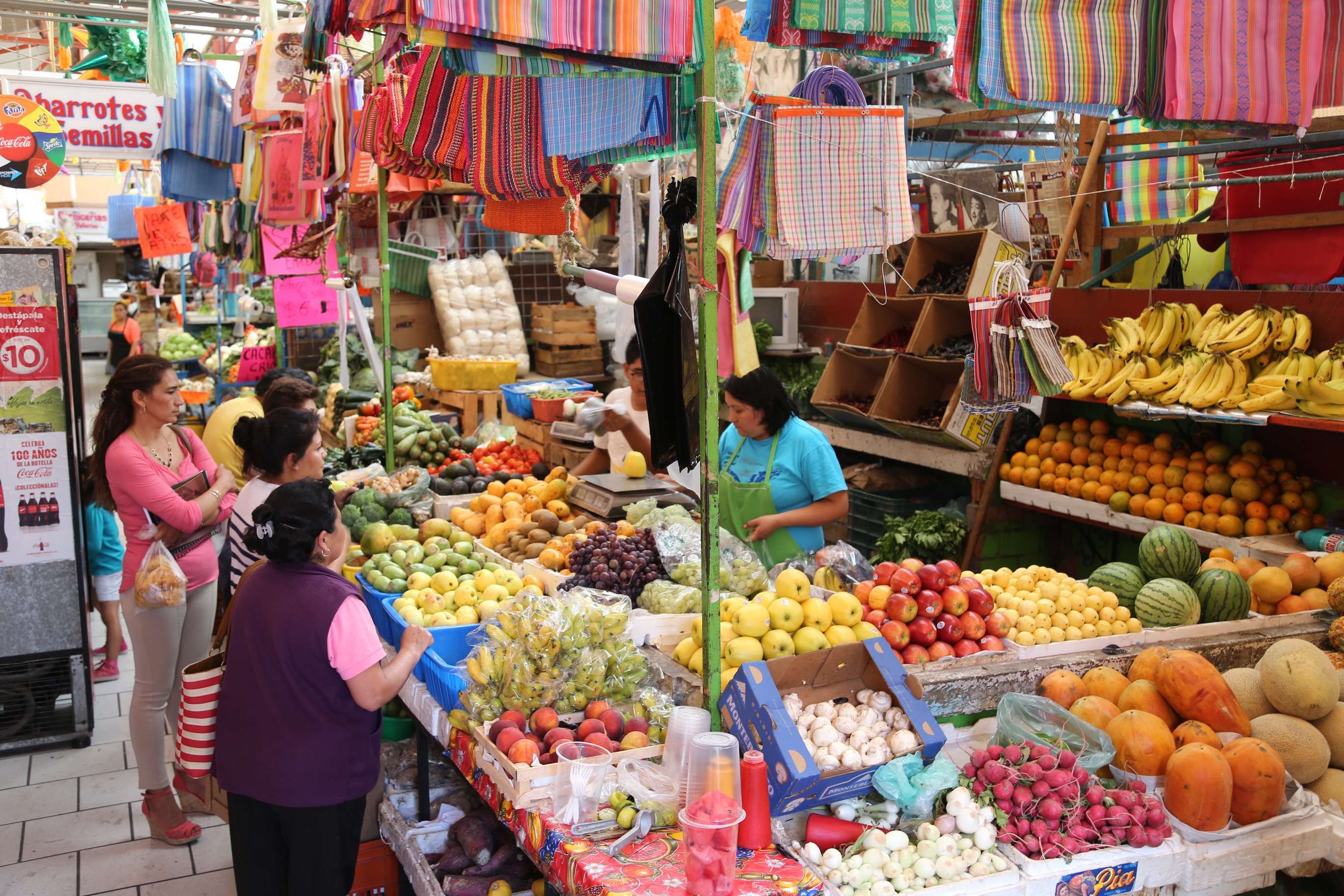 Shopping means you go one place for food, another for staple goods and yet somewhere else for meat. This fruit and vegetable stand always does a brisk business.