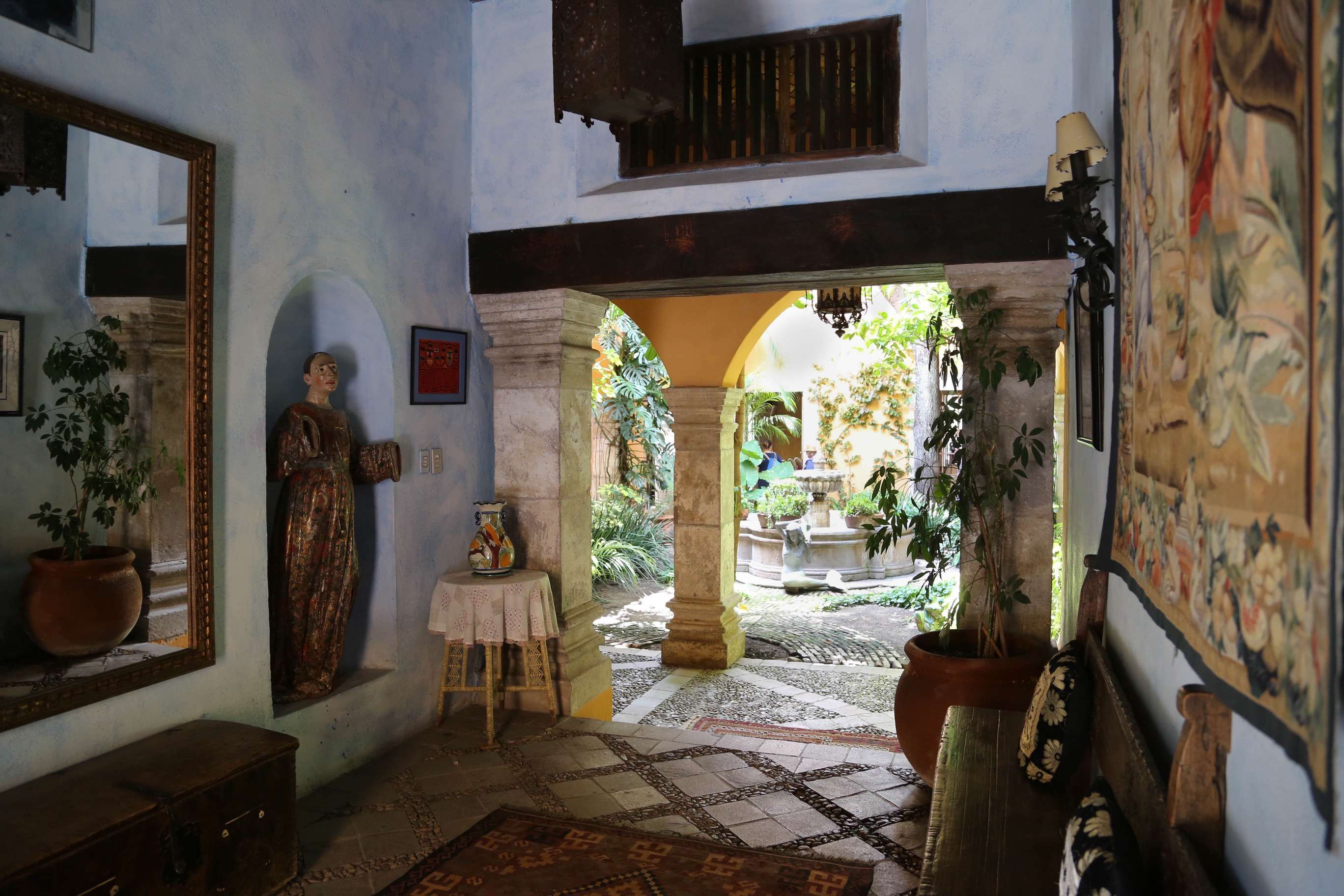 The entry hall of this large home transitions into a lovely courtyard with a tranquil fountain.