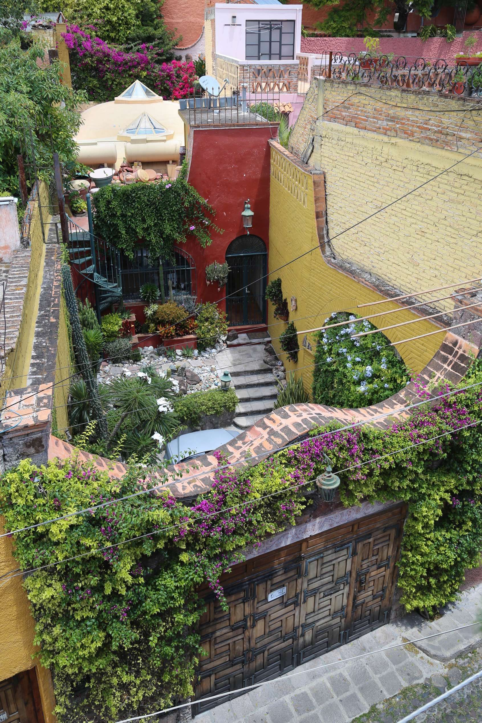 From a high vantage, the beauty of a home's courtyard reveals itself.