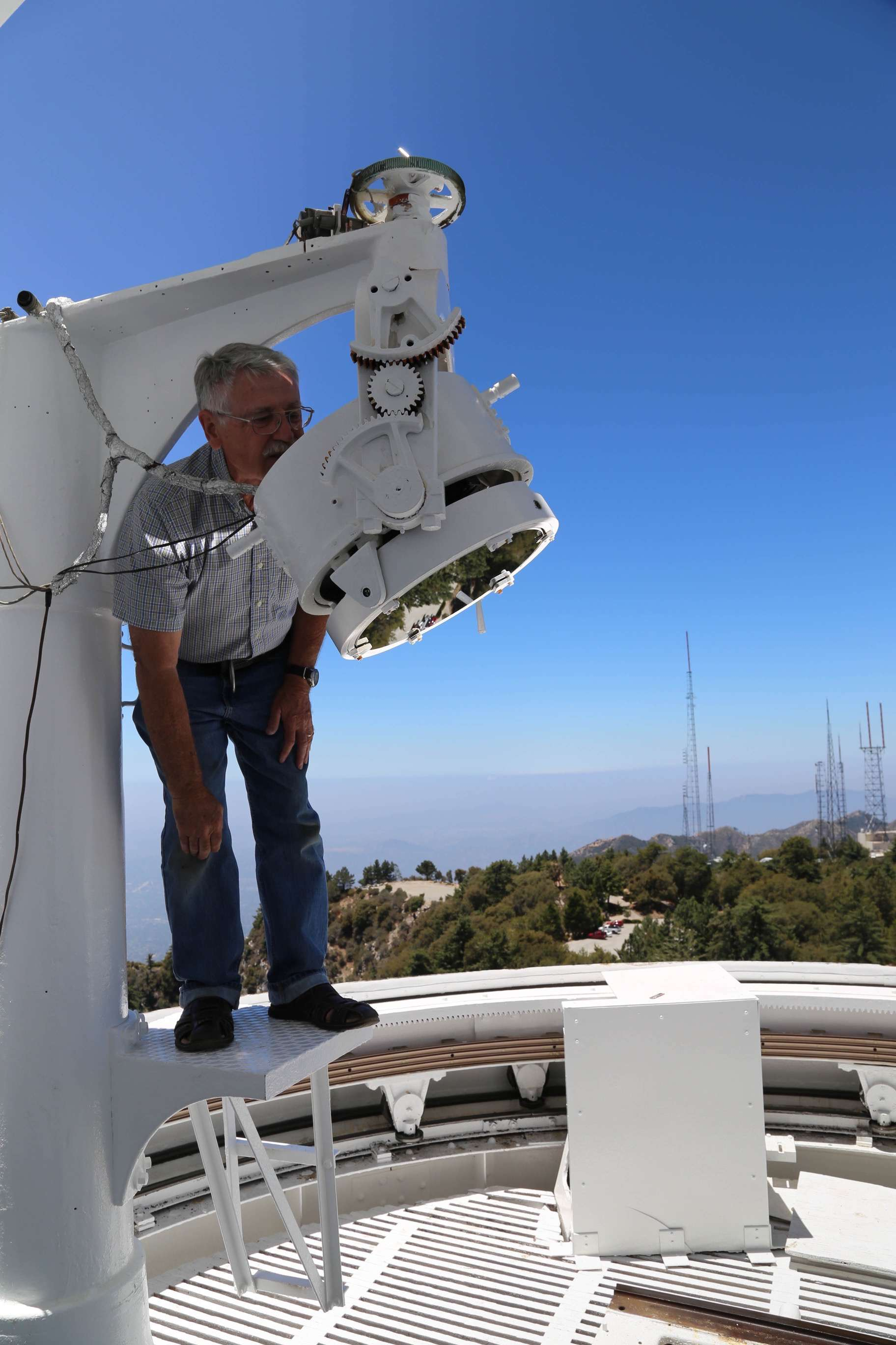 One last look at adjusting the upper mirror on the 150-foot solar observatory and researchers are good to go.