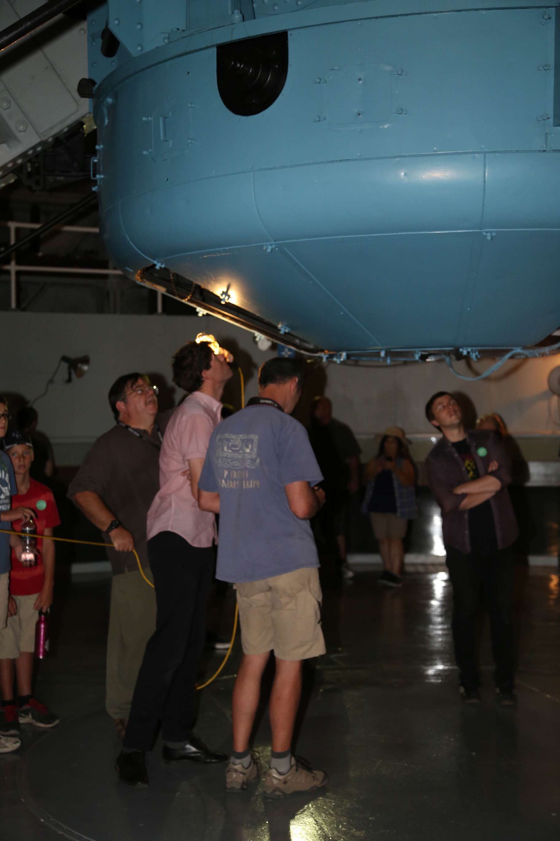 Visitors peer up to see the massive base mirror of the 100-inch telescope.