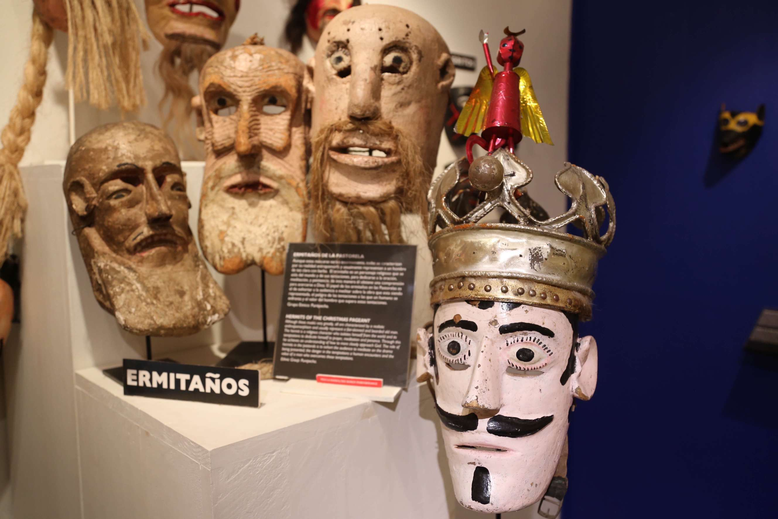 Information signs in both Spanish and English provide museum goers with background on the type of mask and its meaning.