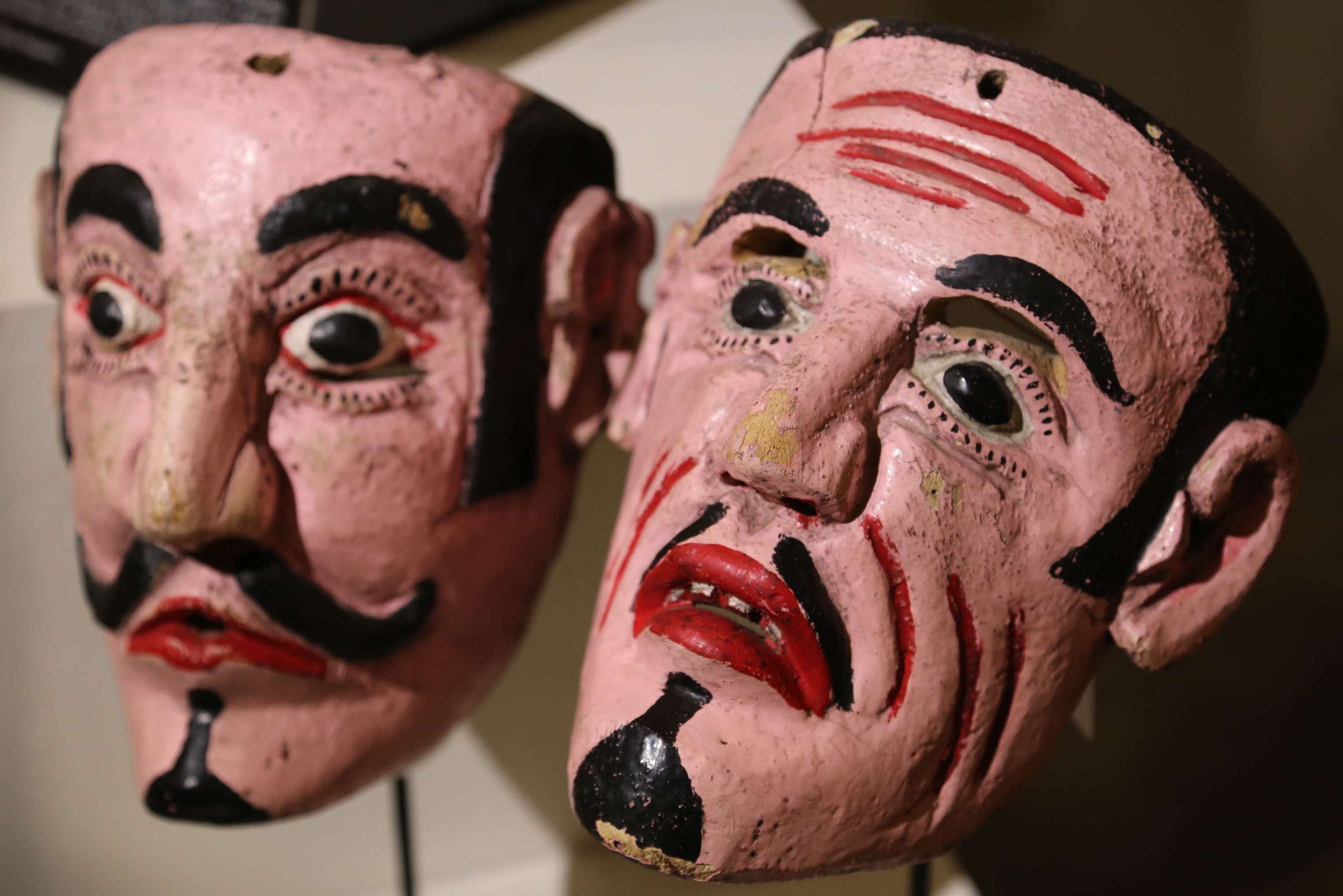 Though only wood and paint, the masks in the museum convey emotion and pathos.