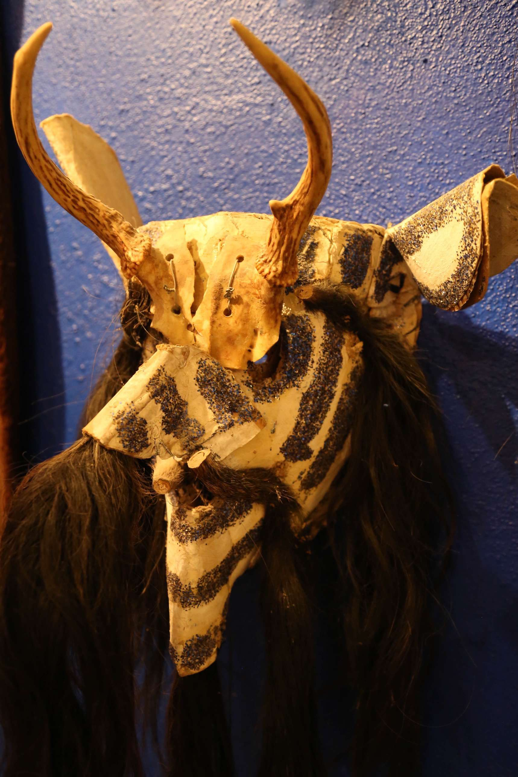 While most masks are made of wood, some, like this one, are made of leather or other materials.