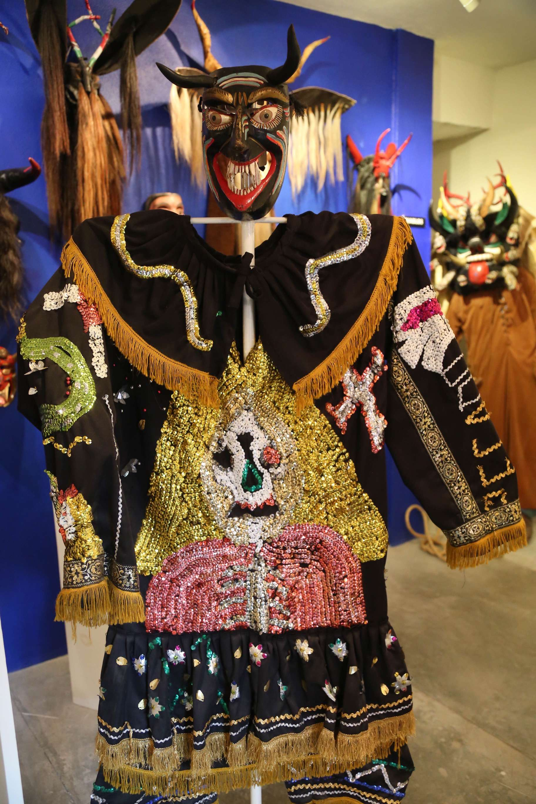 Using more modern materials, like the sequins in this costume create a vibrant look not possible a century ago.
