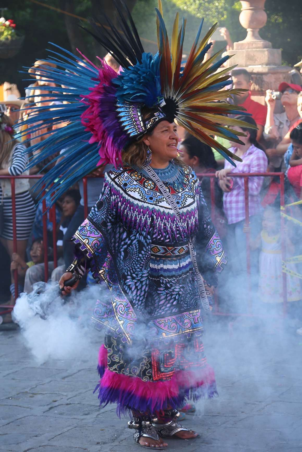 This woman is smokin' hot in her costume as she pauses in El Jardin during a parade in San Miguel de Allende, Mexico.