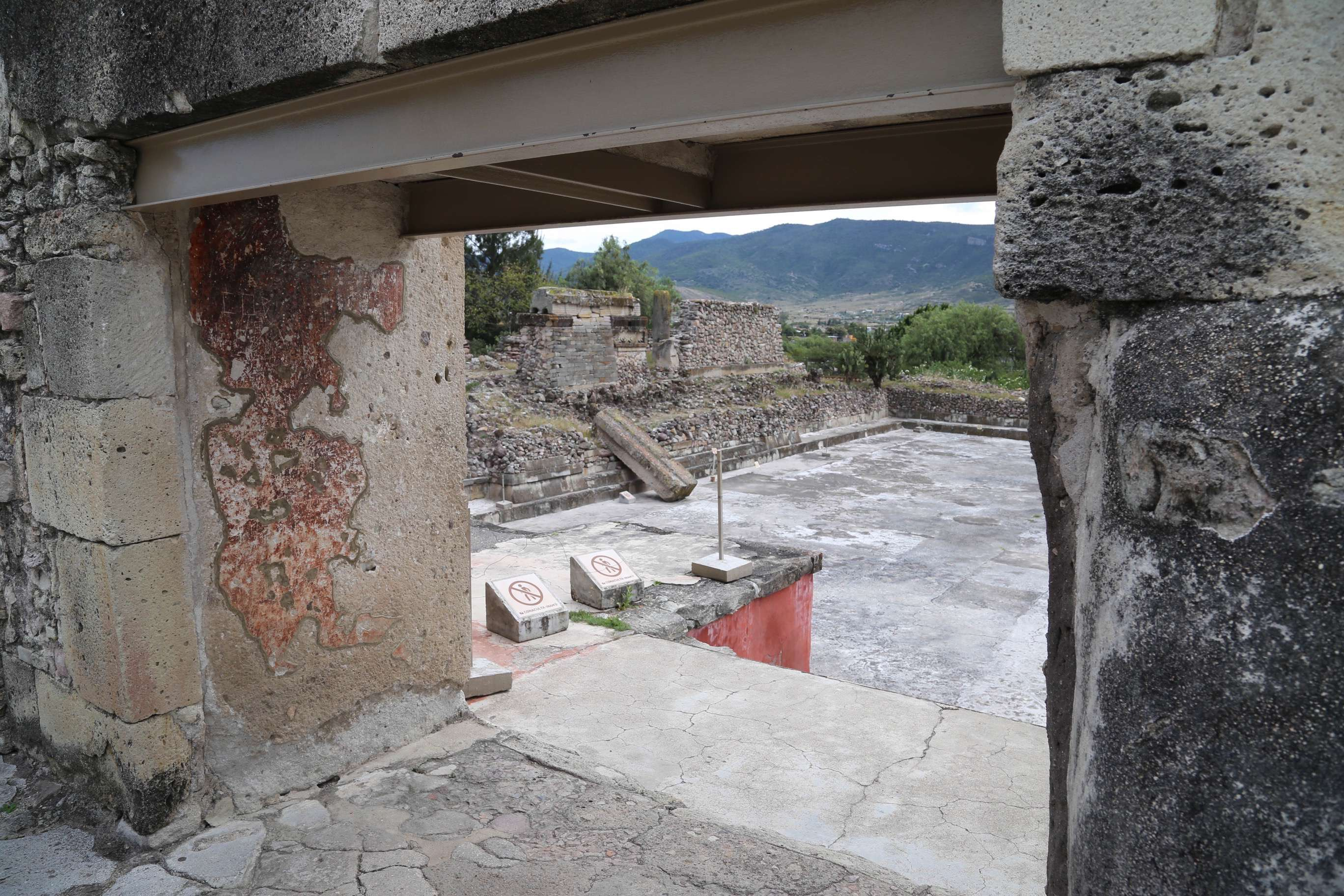 A view from atop one of the temple buildings at Mitla looking out to the main courtyard, below.