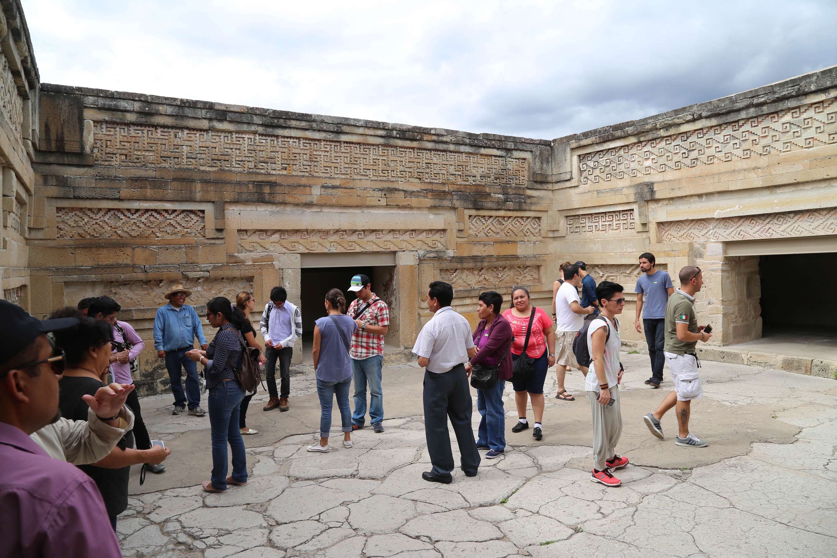 This group, in the courtyard atop one of the buildings at Mitla is small compared to the crowds at many of the archaeology sites in Mexico.
