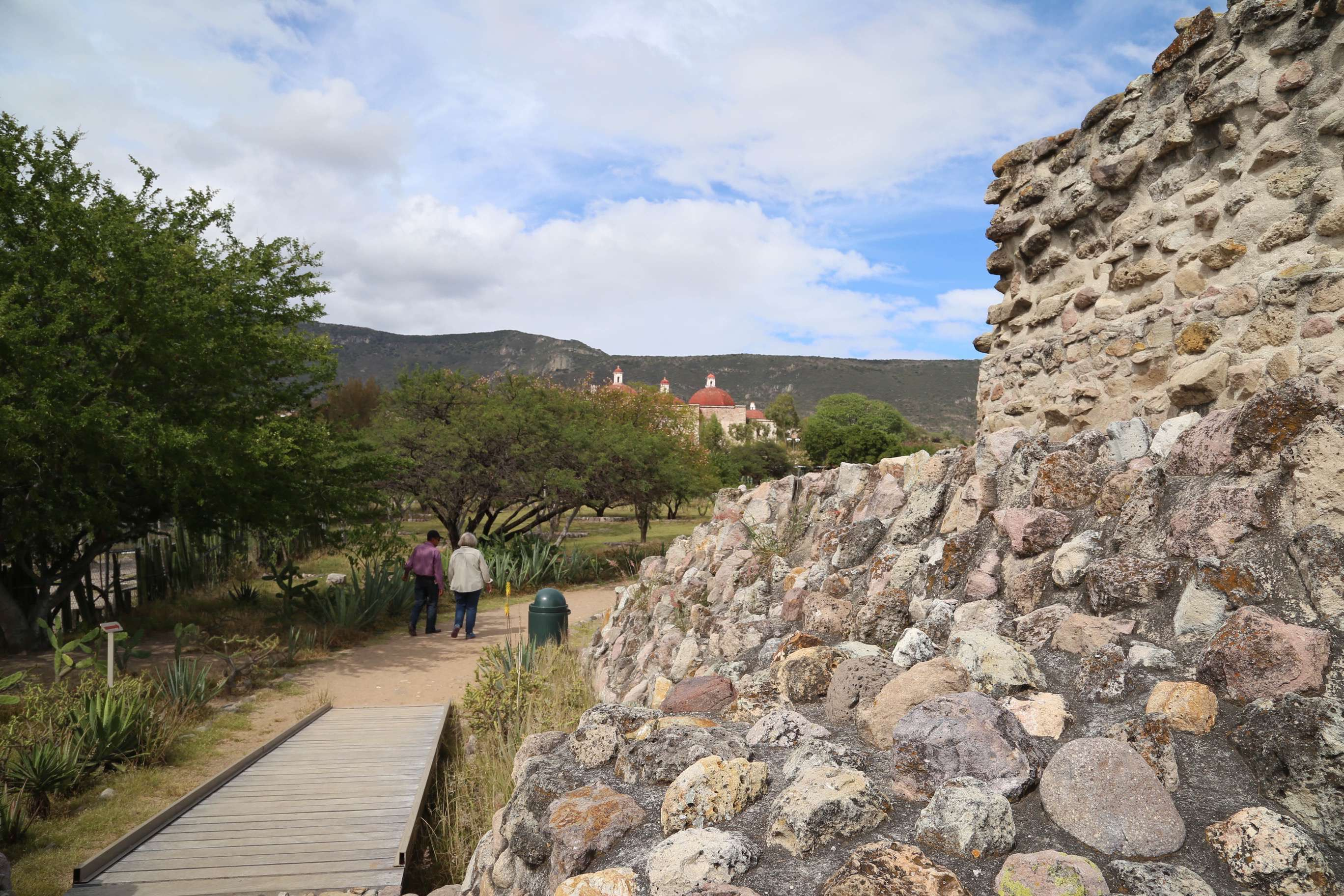 The San Pablo Apostol Catholic church, background, is built in large part with the stones taken from the temples at Mitla by Spanish colonists.
