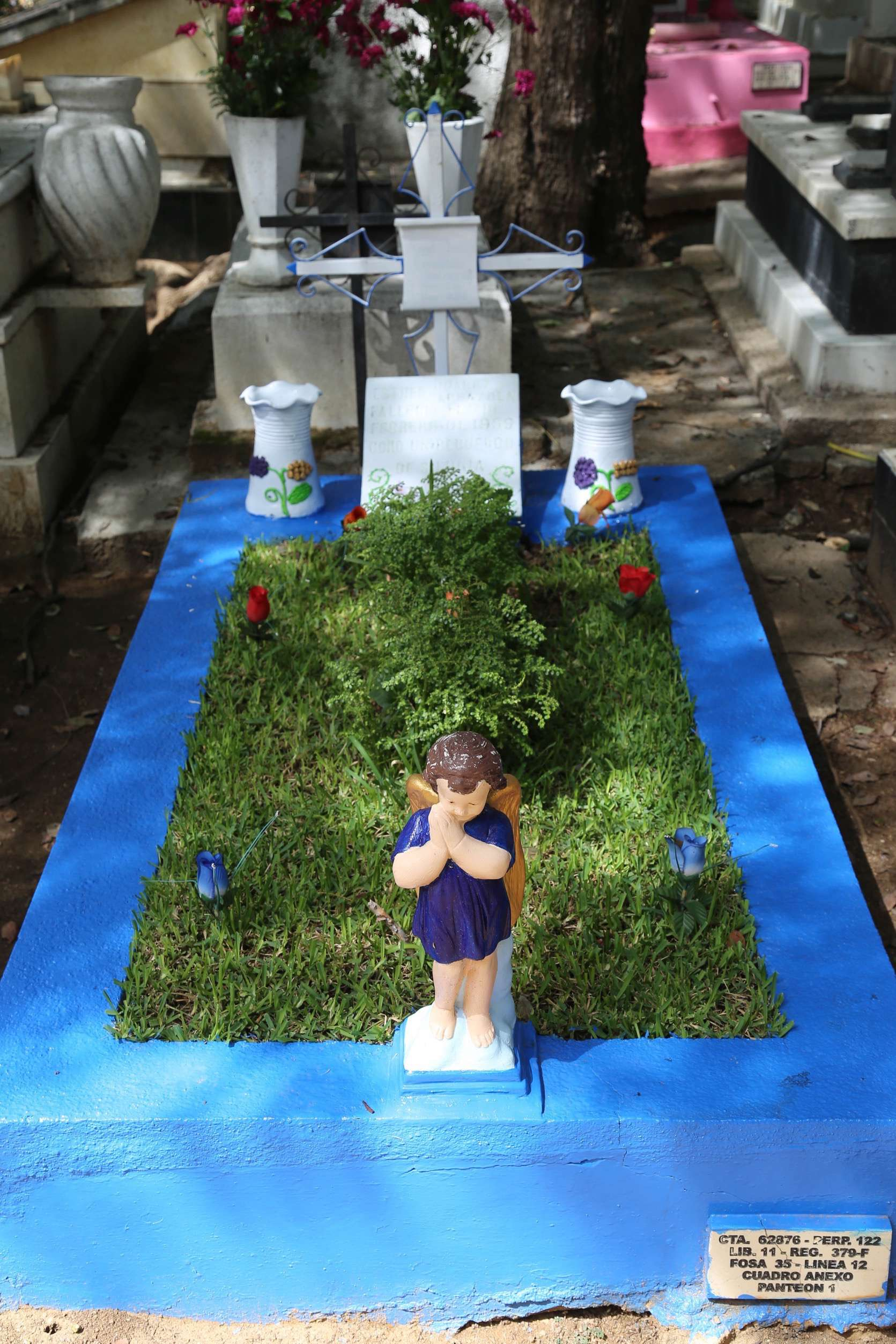 This modest grave in Oaxaca city's Panteon General Cemetery has recently been cleaned up and fresh paint adds color.