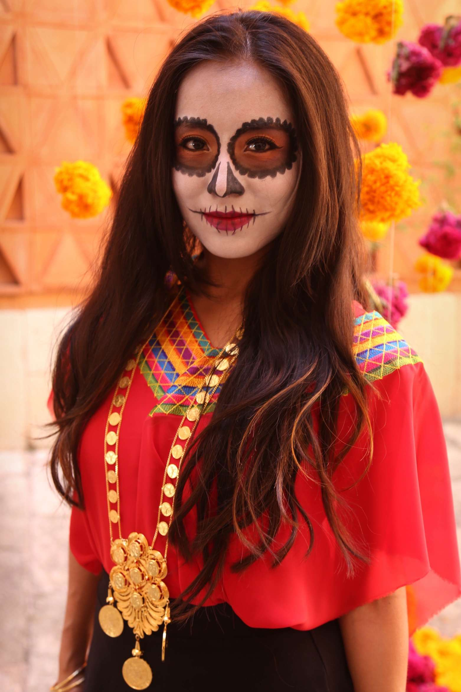 Part of the fun during Dia de los Muertos is to get your face painted.