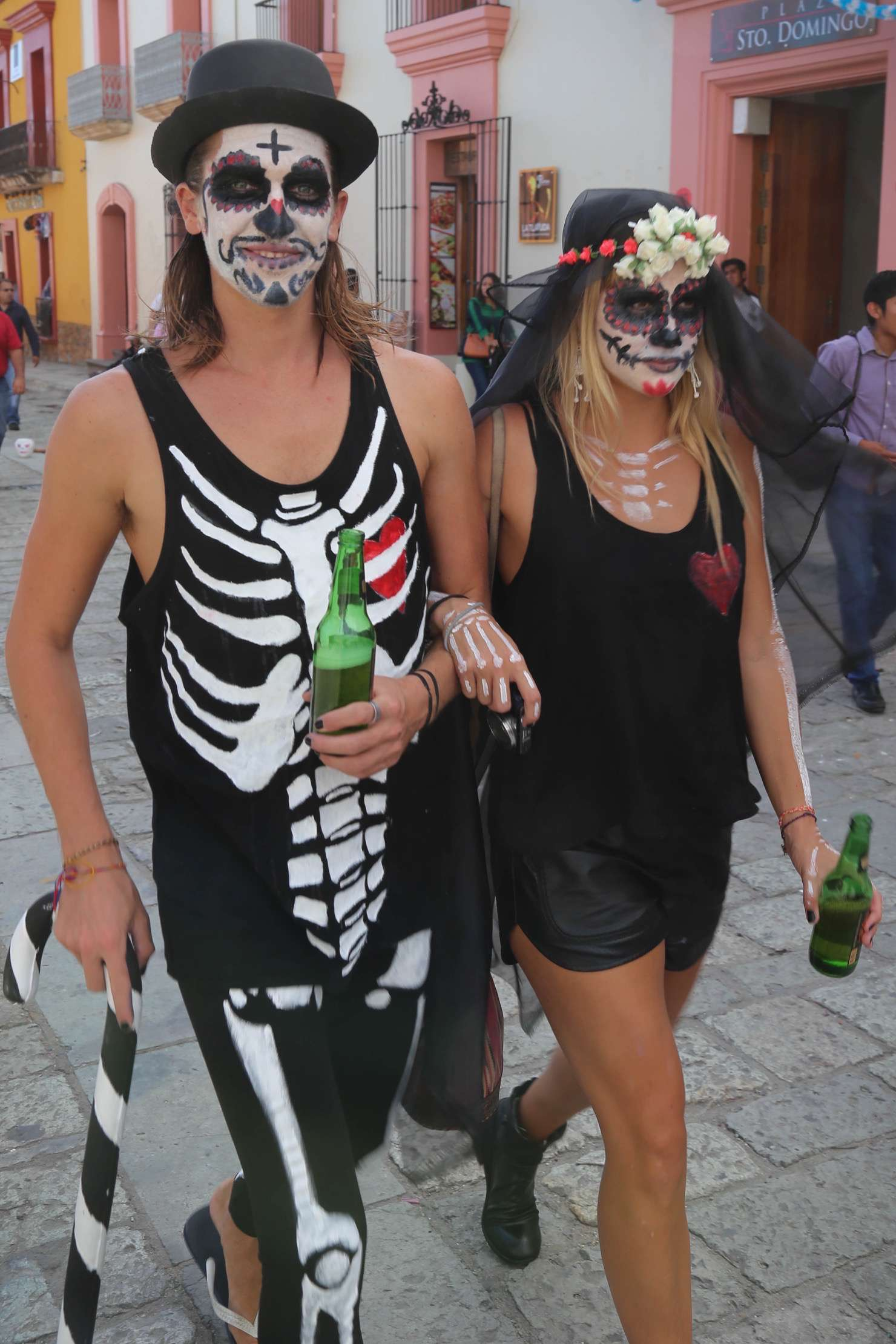 Out for an afternoon stroll these Dia de los Muertos celebrants in Oaxaca city don't seem put off by death.