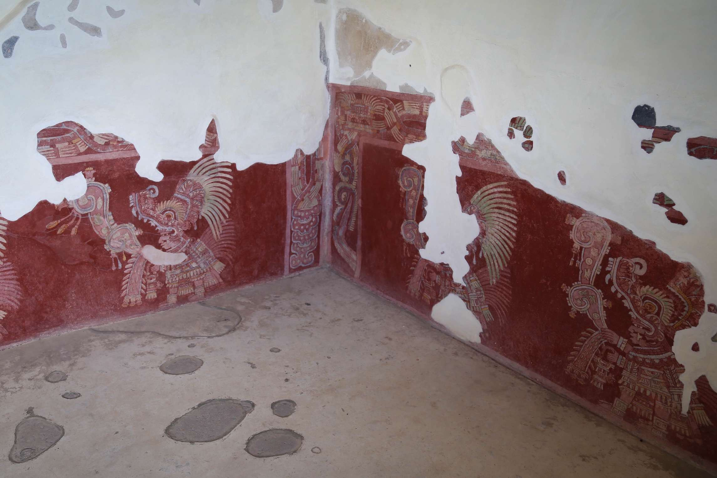 Scientists believe the walls in this home were covered with this pictographic art that told stories of the people who lived and worked at Teotihuacan.