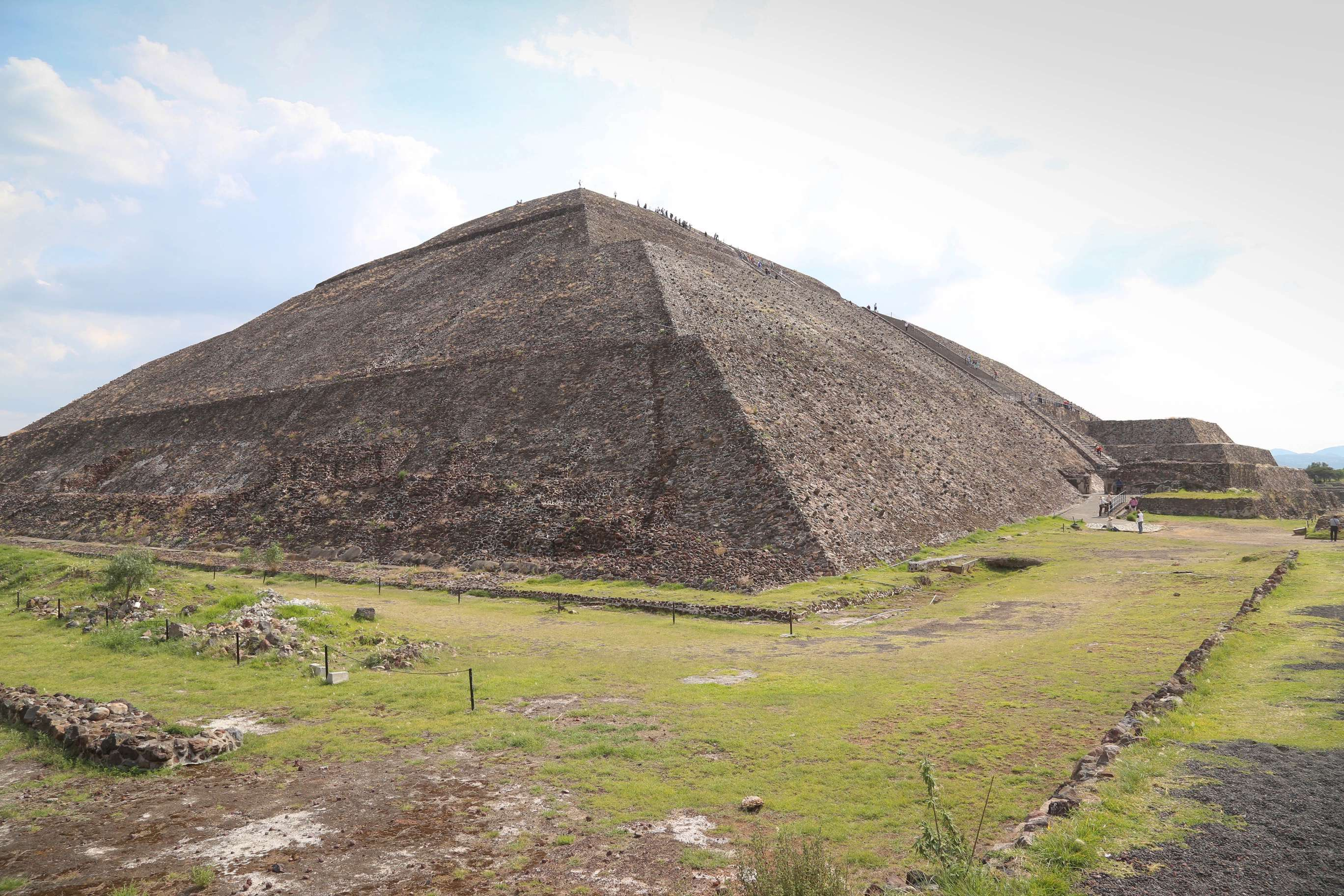 Teotihuacan's Pyramid of the Sun is one of the most popular places to visit and people carefully climb the steep stairs for a view at the top.