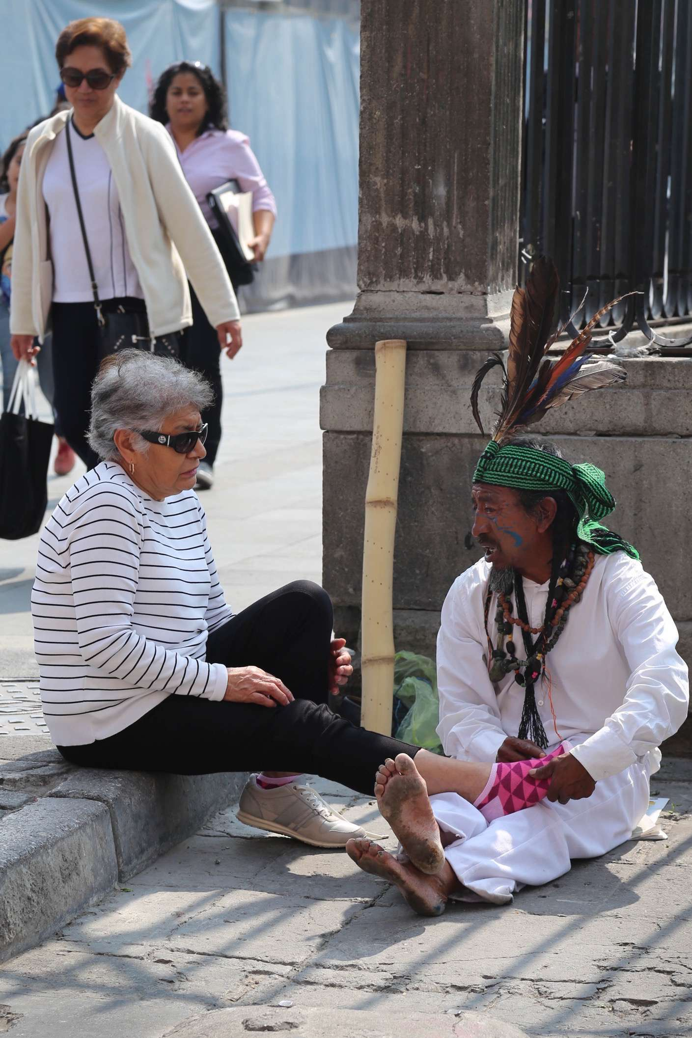 """Tell me where it hurts,"" this street 'doctor' might be saying to the woman as she winces during an exam just off the Grand Zocalo."