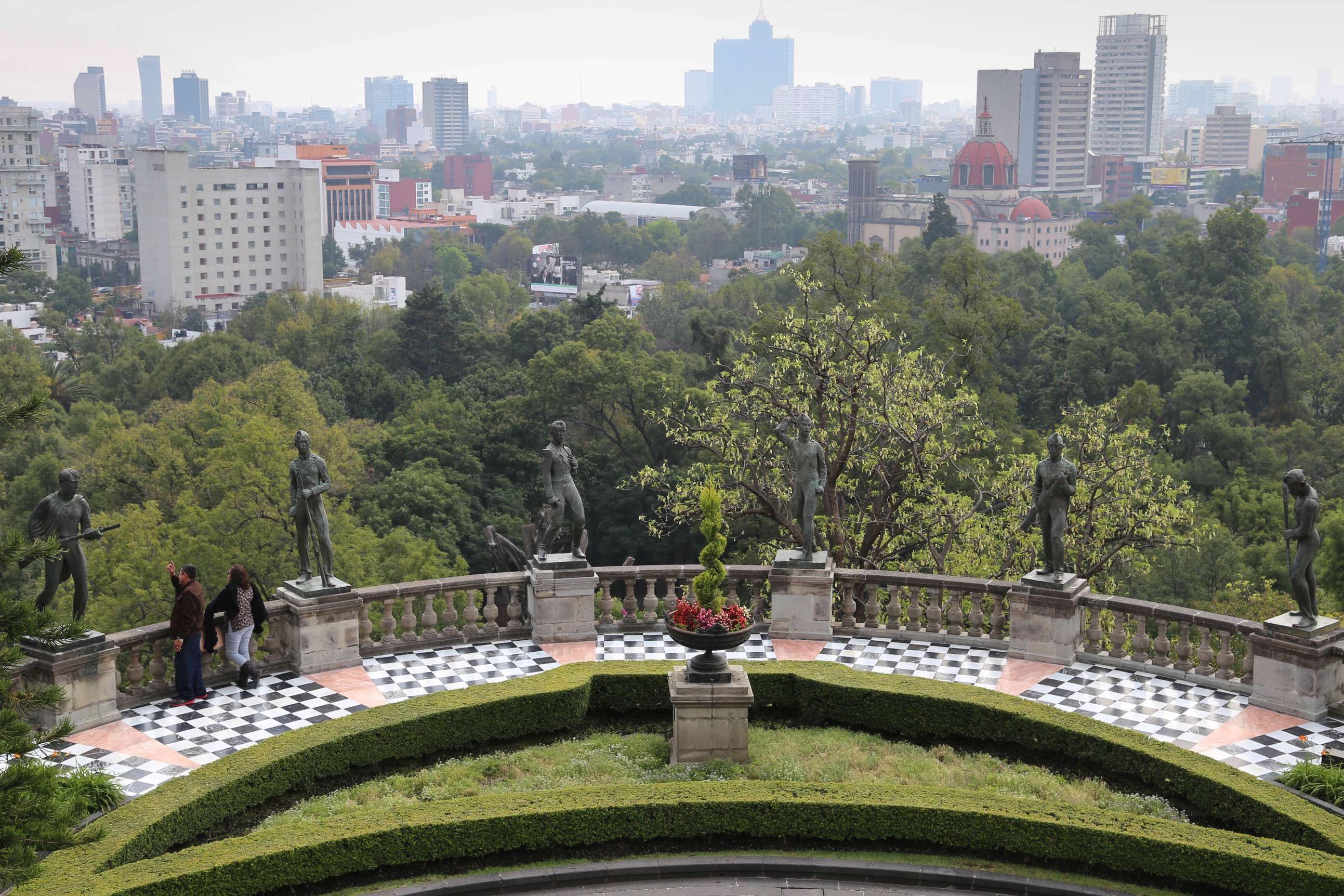 From the balcony of Chapultepec Castle in Mexico City, elements of history, both old and new fill the frame.