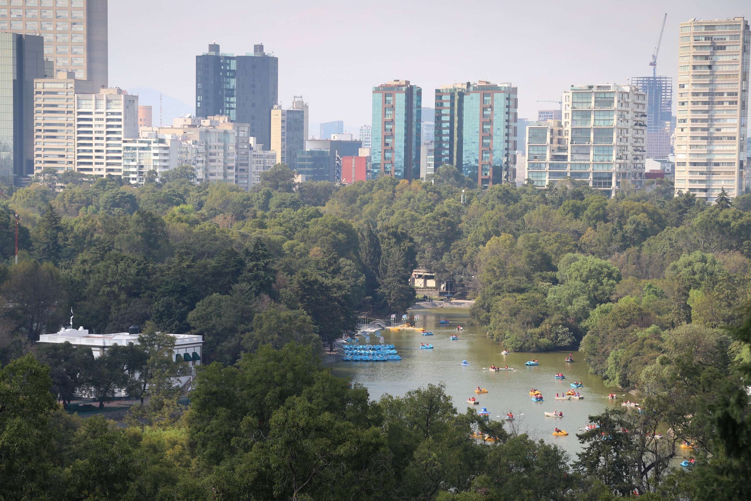 From Chapultepec Castle, the park's lake and barrios beyond make Mexico City a busy place.