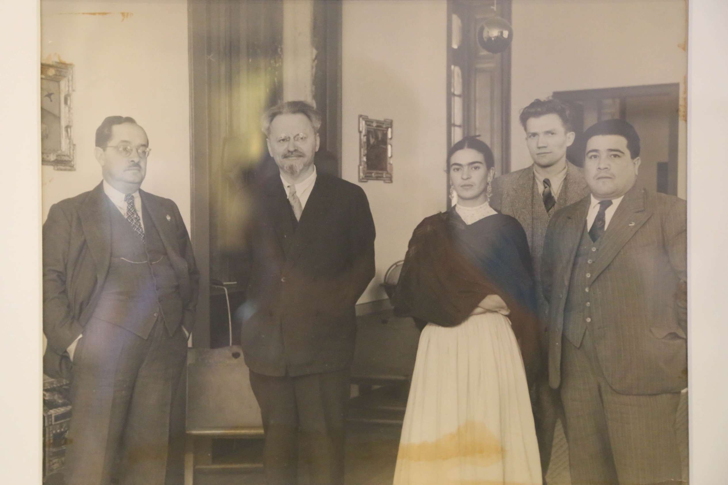 This photo on a wall in a room at Casa Azul shows Frida Kahlo with her friend, and lover, Leon Trostky, second from the left.