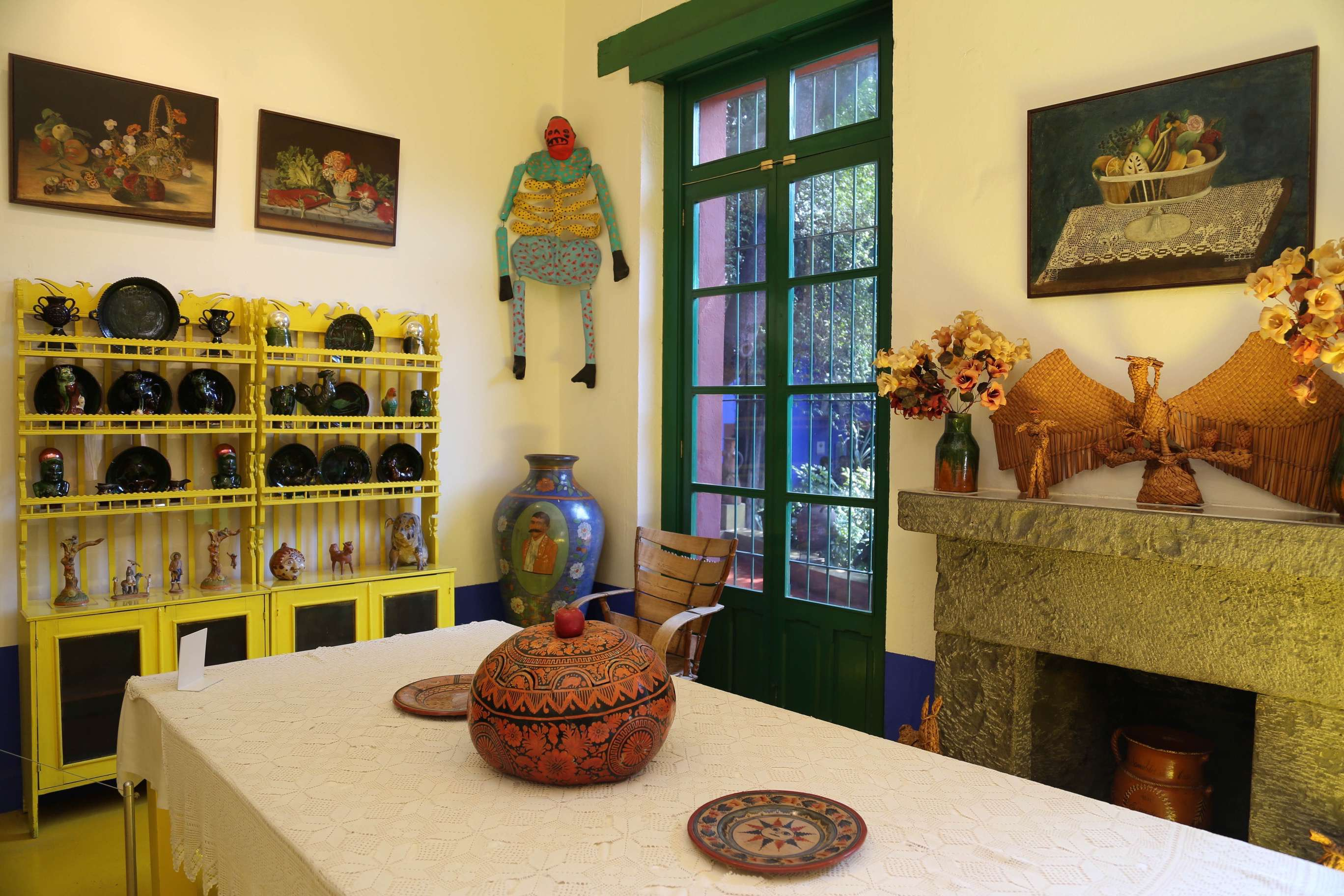 The dining area at Casa Azul shows the bright colors and traditional themes that are found throughout Casa Azul.