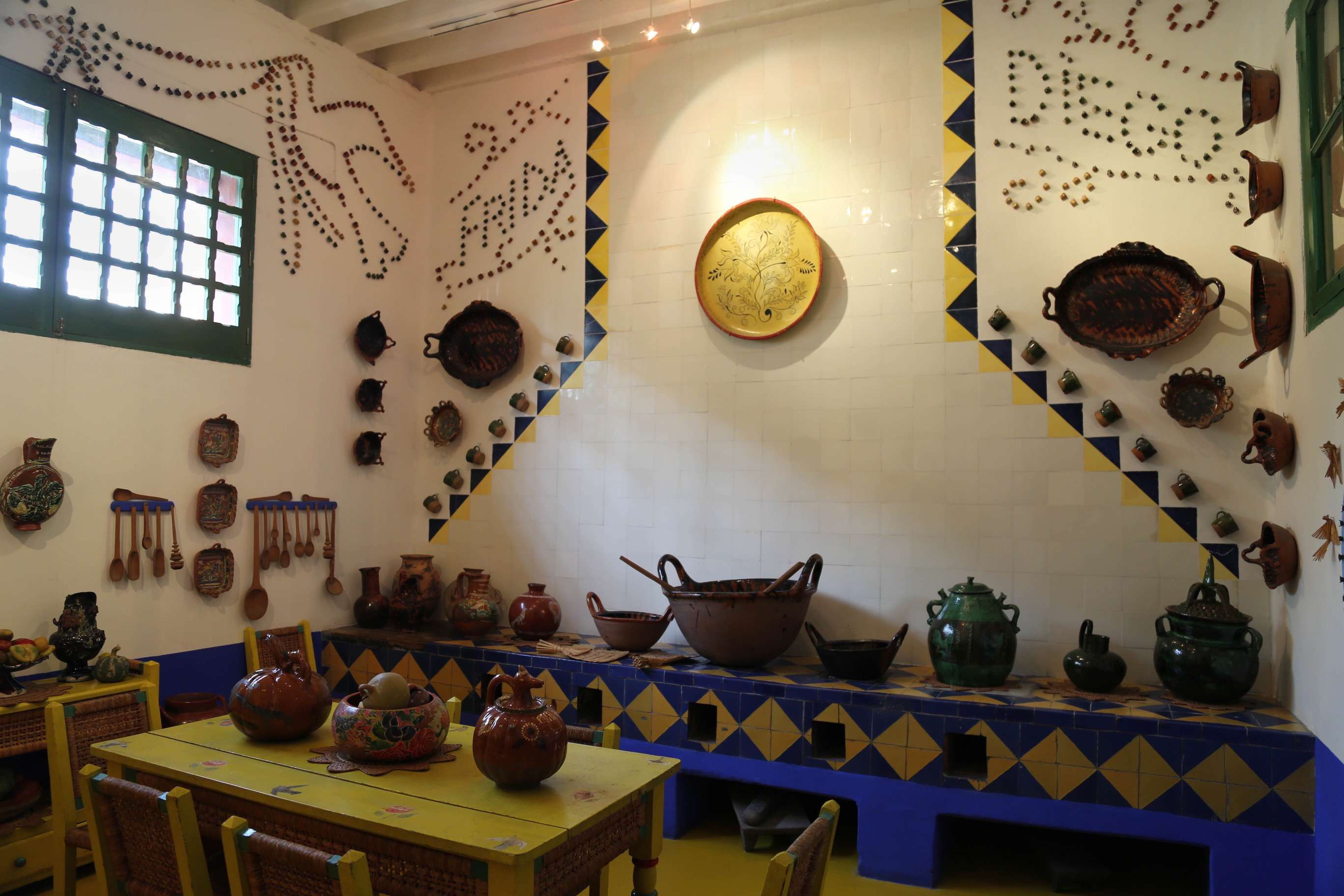 The kitchen at Casa Azul. Though modern stoves and ovens were available, Frida Kahlo and Diego Rivera liked to cook in a more traditional manner.
