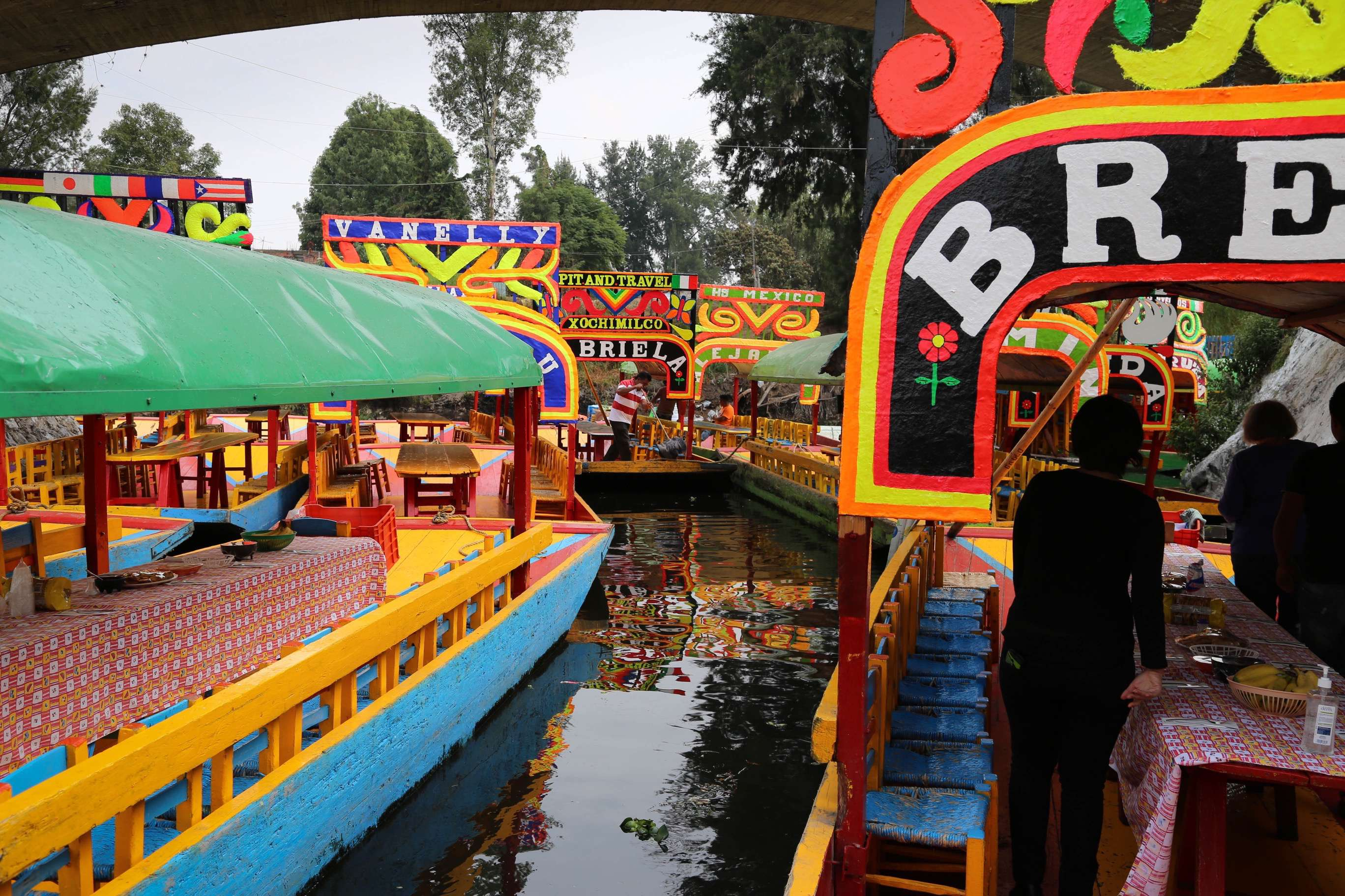 Boats negotiate their way along at the canals of Xochimilco.