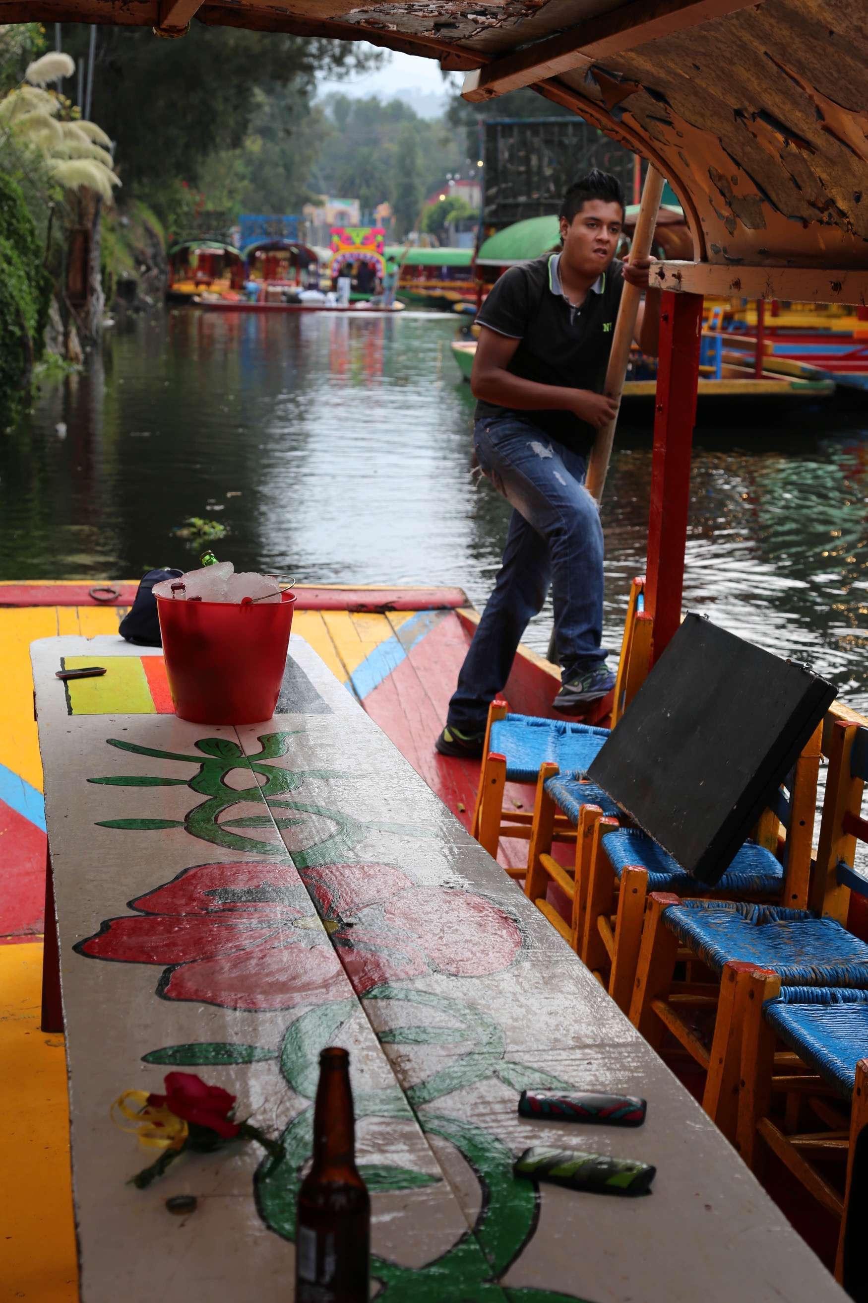 A 'captain' poles his trajinera along the water.