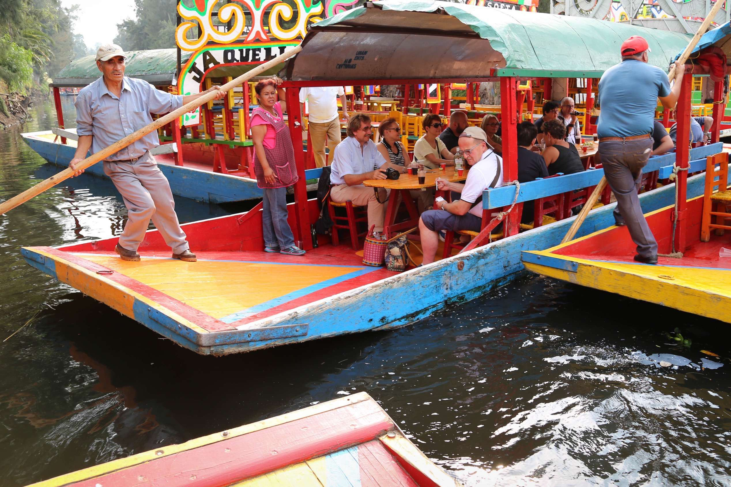 Even on a weekday afternoon, boats must jockey for position along the canals.