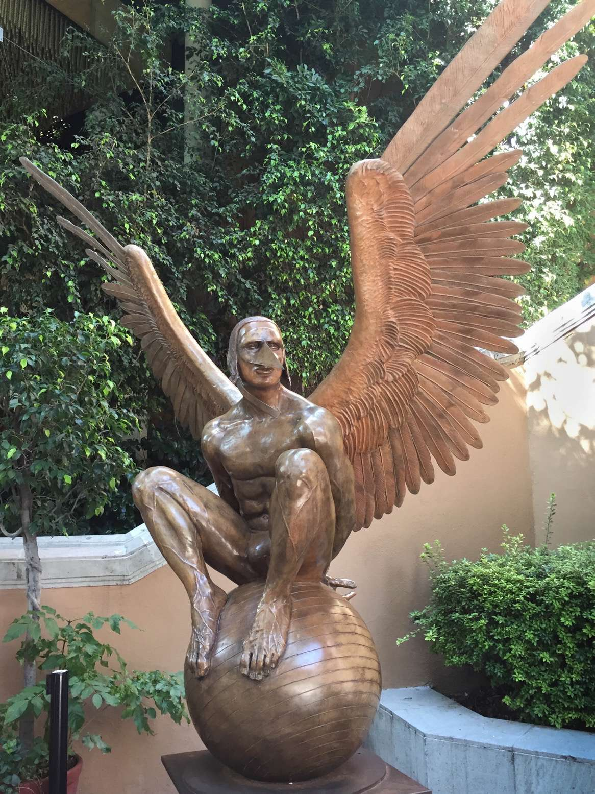 This is one of Jorge Marin's famous bronzes, Monumental Perselidas Angel, on public display in Mexico City. Wings, masks, spheres and boats are often elements in Jorge's distinctive sculptures.