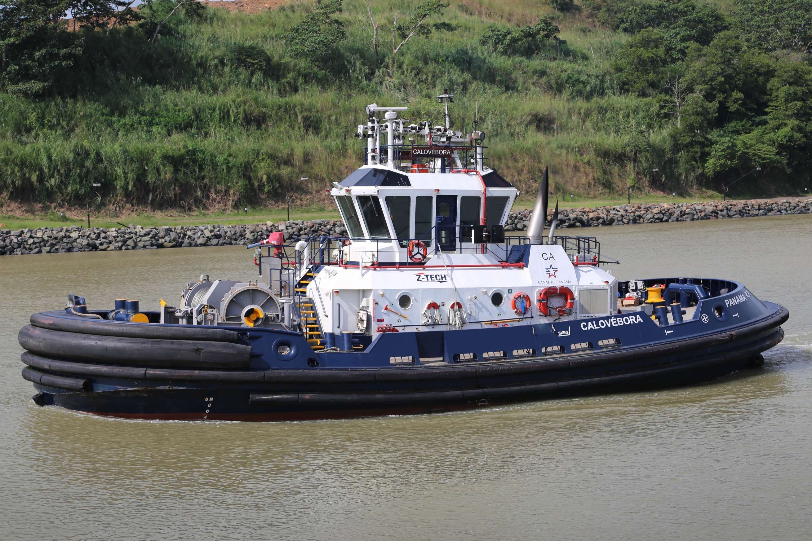 Only experienced crews work on the tug boats because an accident could halt the passage of ships at the busy Panama Canal.