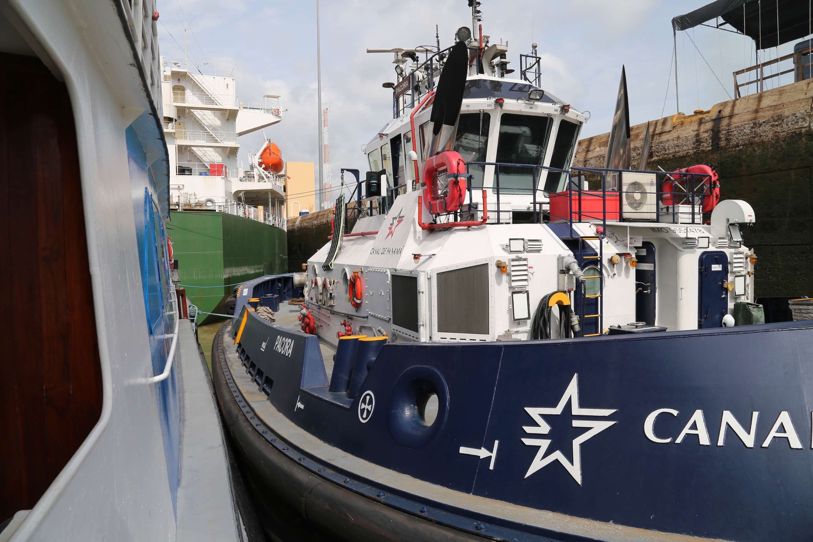 The locks are huge upon approach, but canal personnel don't want to waste water so as many ships and boats as possible are tucked in.