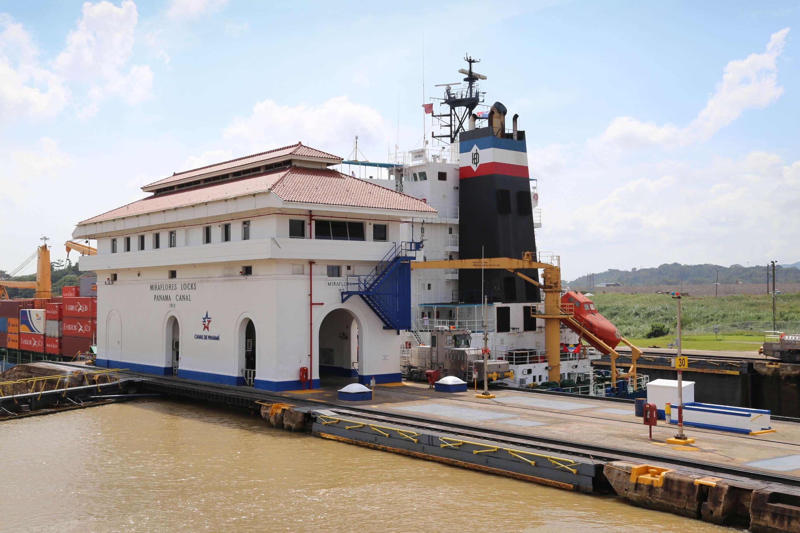 The cargo ship Gloria passes by the Miraflores Locks control tower on her way toward Panama City.