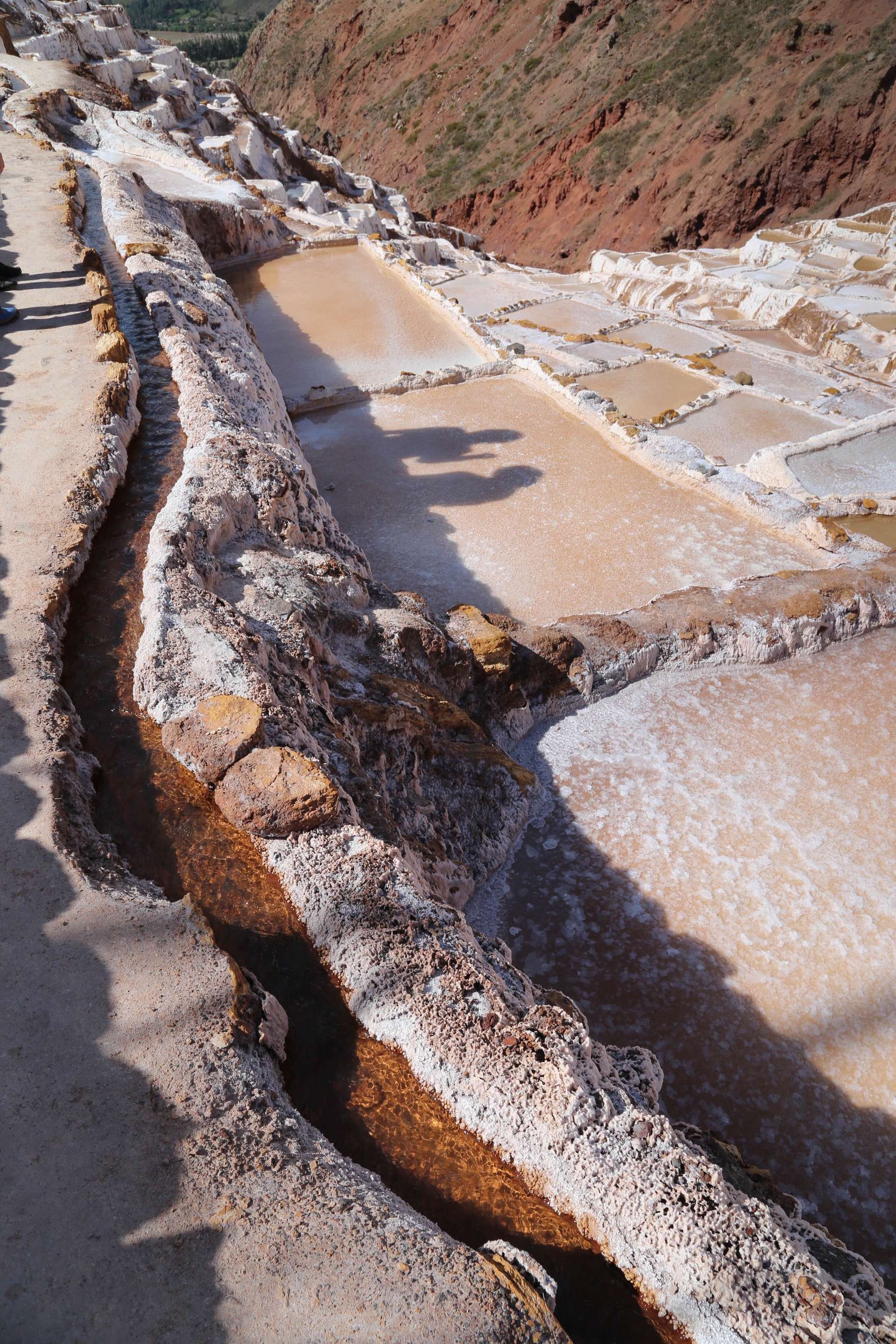 The brine spring, along the upper reaches of the Maras salt works looks clear and clean but it is quite salty to the taste.