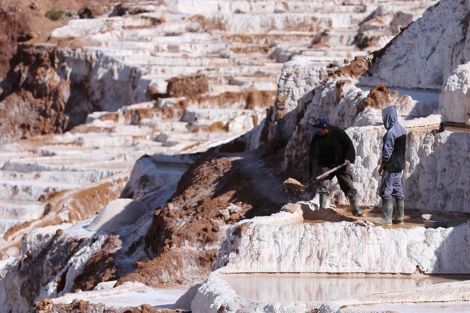 The light reflected off the salt ponds is intense, and cataracts is a problem that salt workers must taken into consideration.
