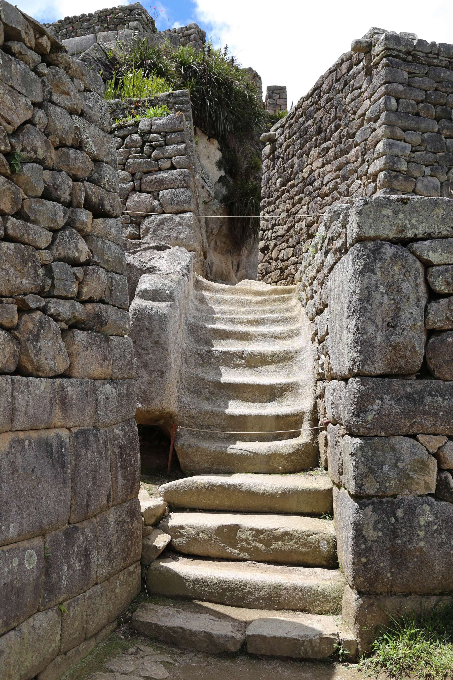 The builders of Machu Picchu used stones to carve stones and the stairs in the middle are a testament to the abilities.