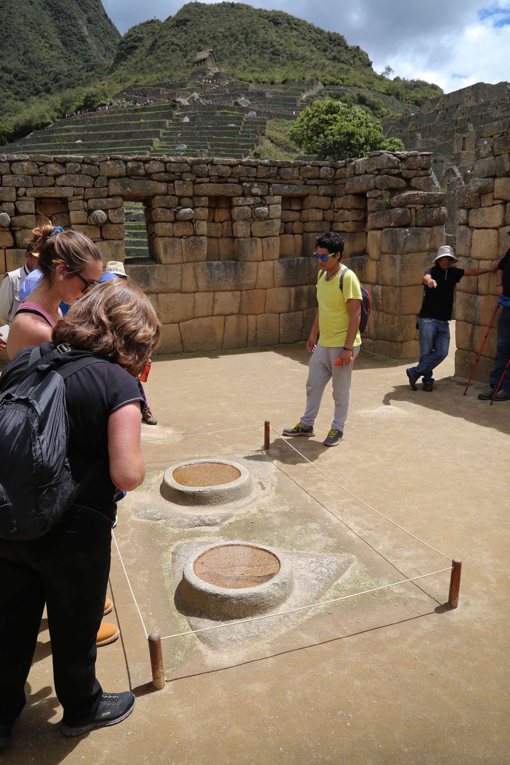 Visitors stare into the water fill bowls while a guide explains they were a type of observatory to watch the sun and heavens. Knowing the celestial and seasonal events was also part of Inca skill.