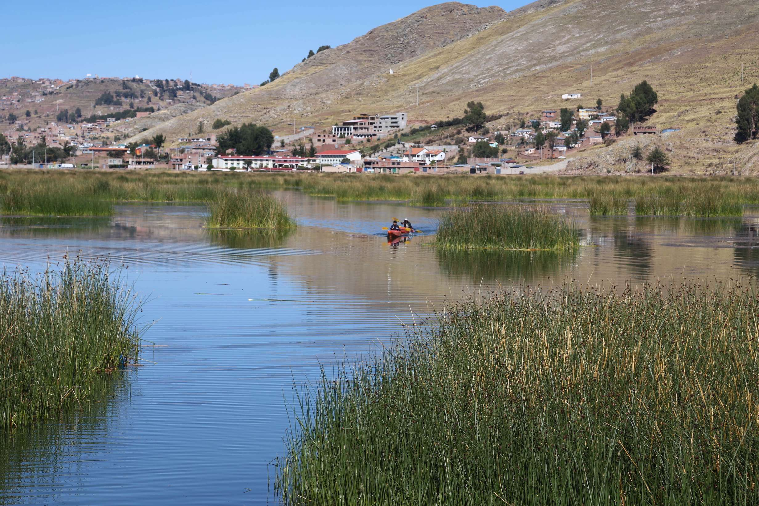 Towns and villages are dotted all along Lake Titicaca. Puno, Peru has a population of over 140,000.