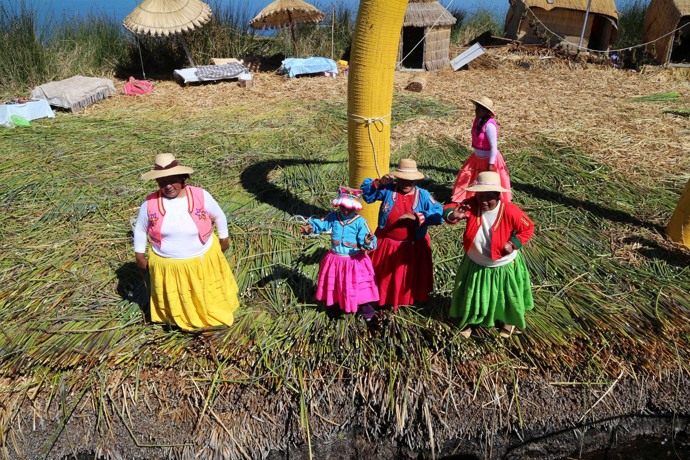 Visitors are greeted by residents dressed in brightly-colored garb.
