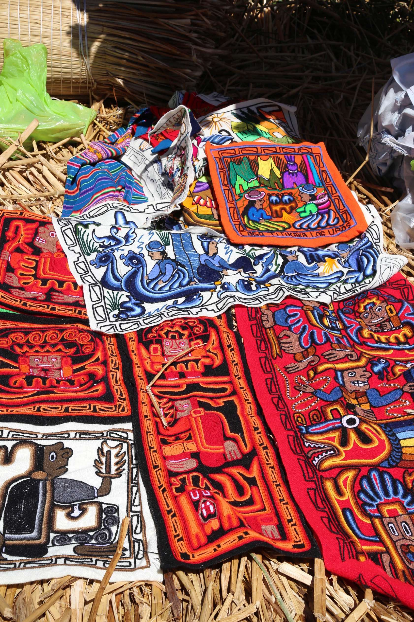A sampling of weaving and textile goods for sale.