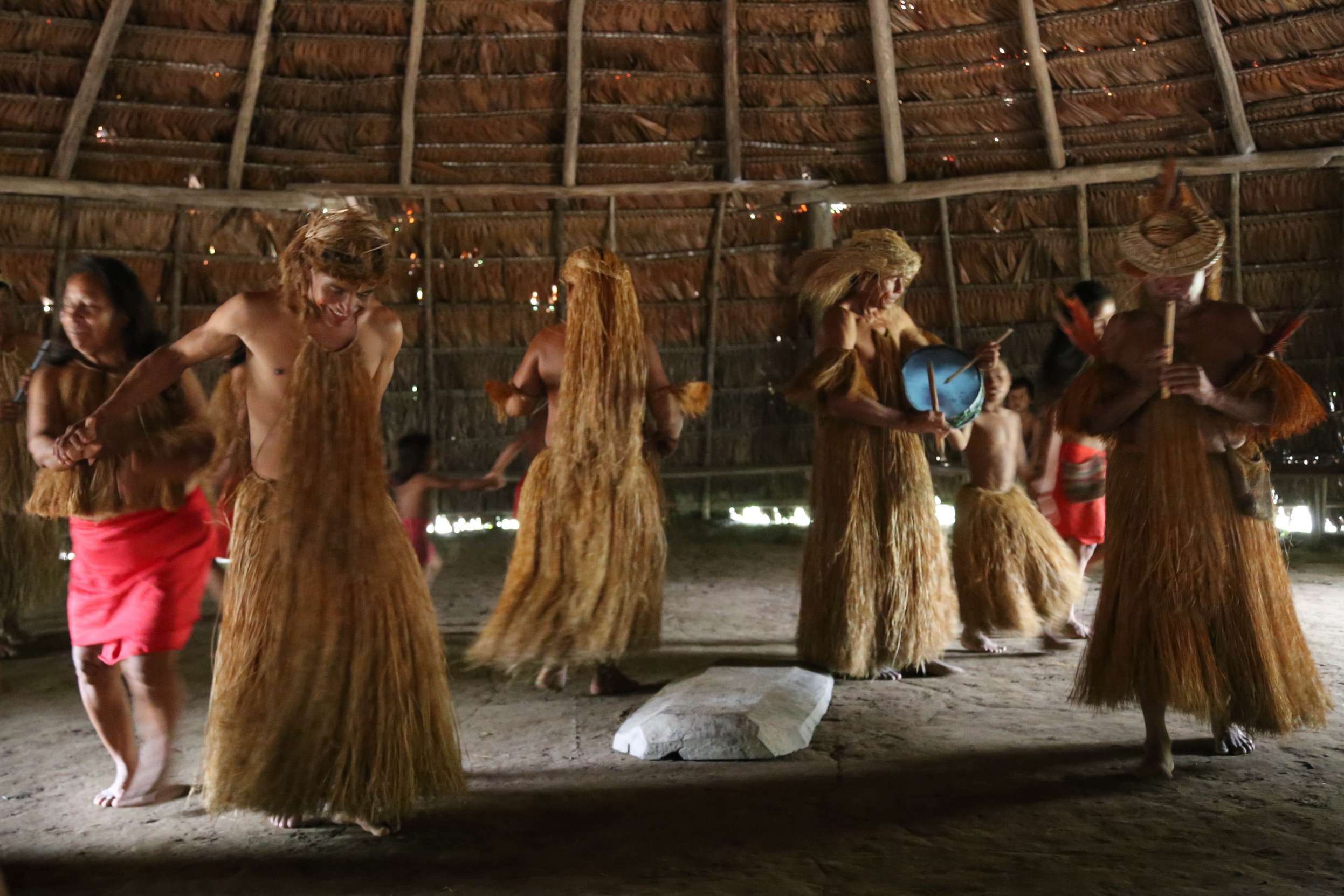 When tourists come for a visit, the members of the group gather in the main hut and perform a few dances, sometimes inviting the tourists to join them.
