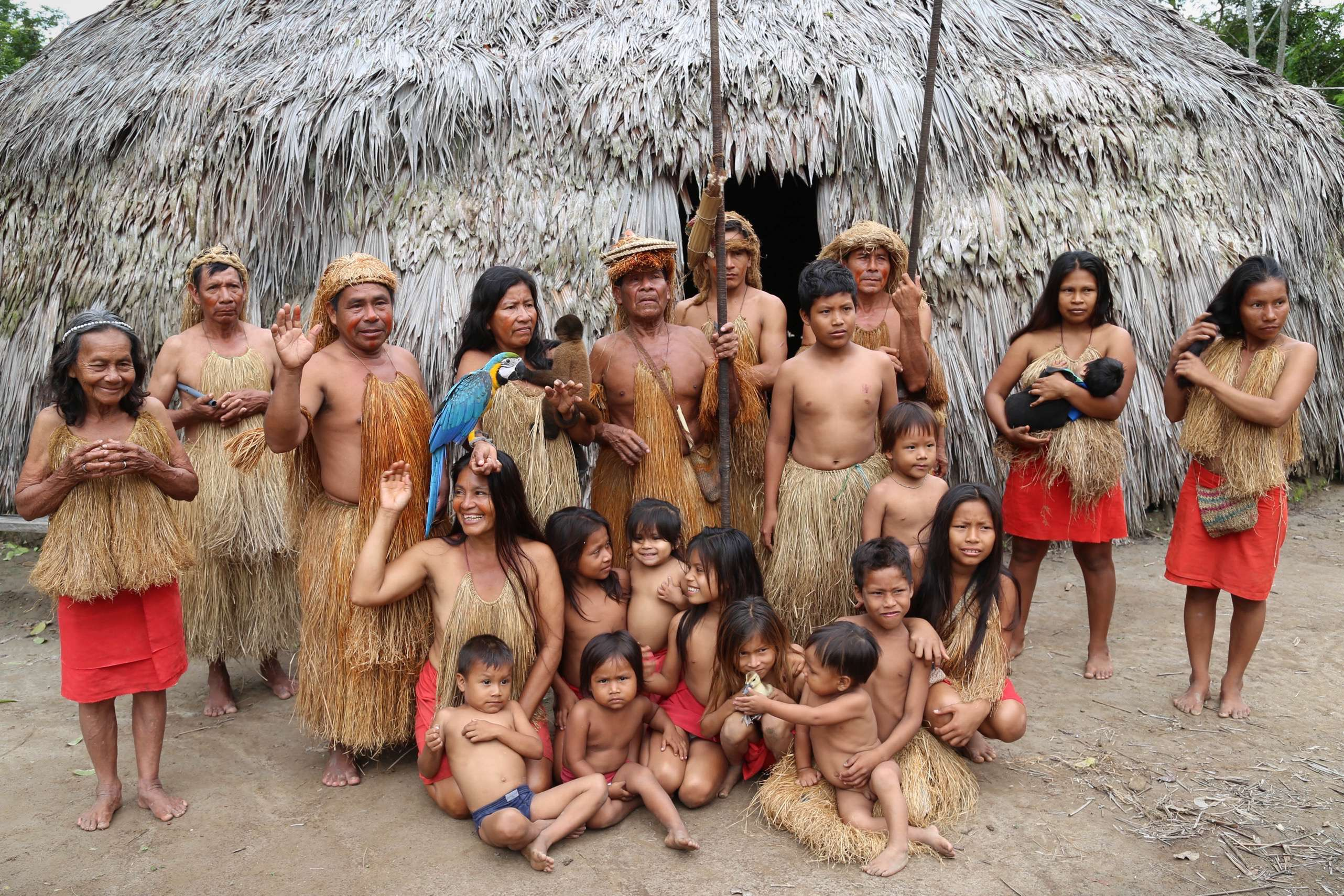 The Yagua live in small groups from two to 30 families. Here they gather next to their main hut for a group portrait.