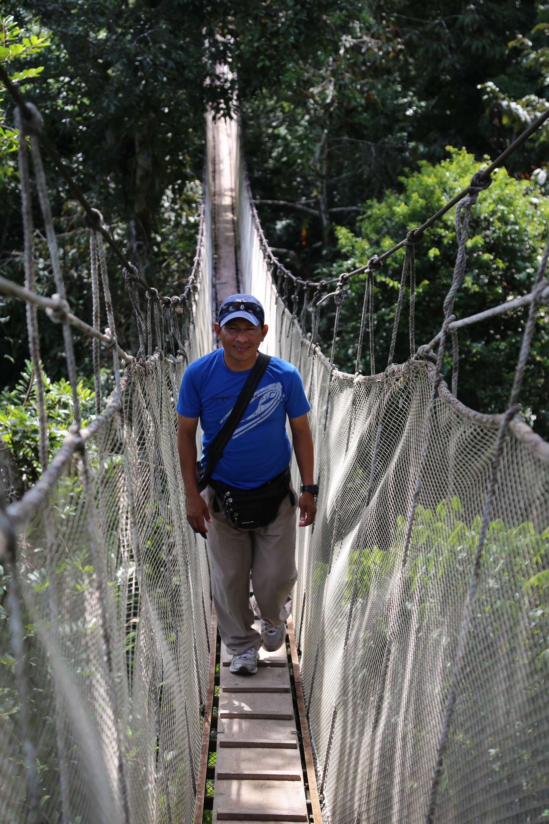 Guide Willie Flores Lanza walks along as surely as if he were on the ground below.
